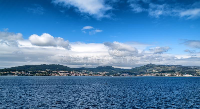 A landscape of mountains from the sea stock images