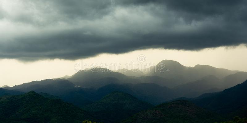 Landscape of mountains at sunset with clouds royalty free stock photo