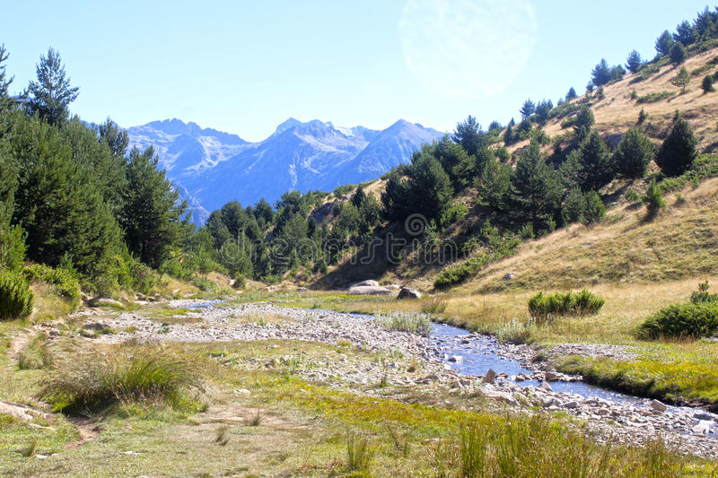 Landscape of the mountains, trees, steam and the sunny sky in the Pyrenees stock photos