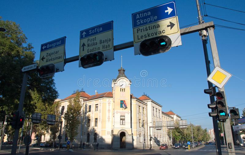 Landscape of Municipal house of City of Nis and traffic signs, Serbia. Landscape of the Municipal house of City of Nis and traffic signs, Serbia. The house was stock photography