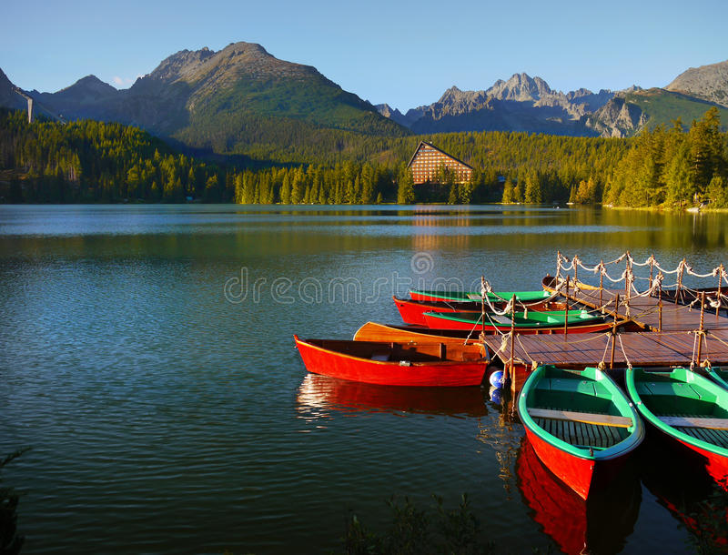 Red Boats on Lake, Mountains Landscape royalty free stock photos