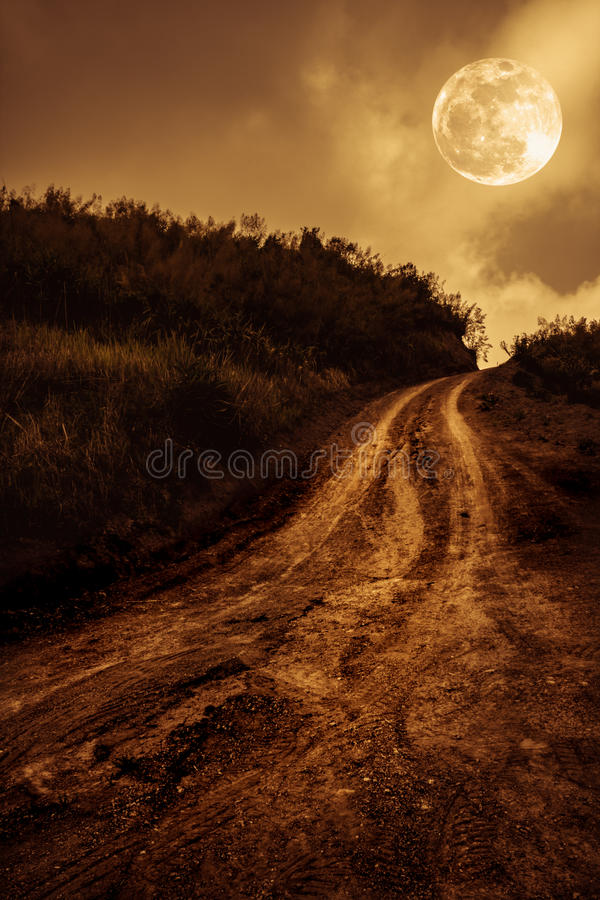 Landscape in nature of beautiful full moon with a muddy road through a forest. stock photos