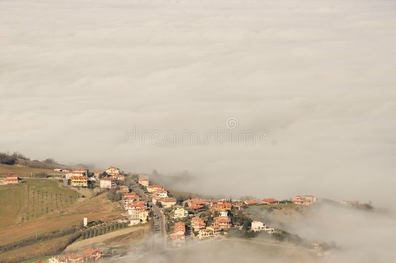 Landscape of nature in the fog of San Marino country in Italy stock photo