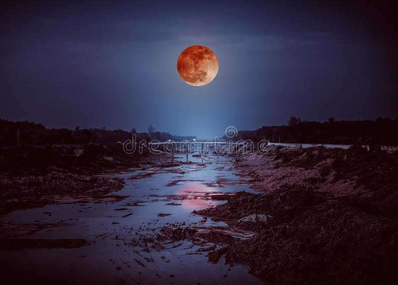 Landscape of night sky with many stars and blood moon royalty free stock image