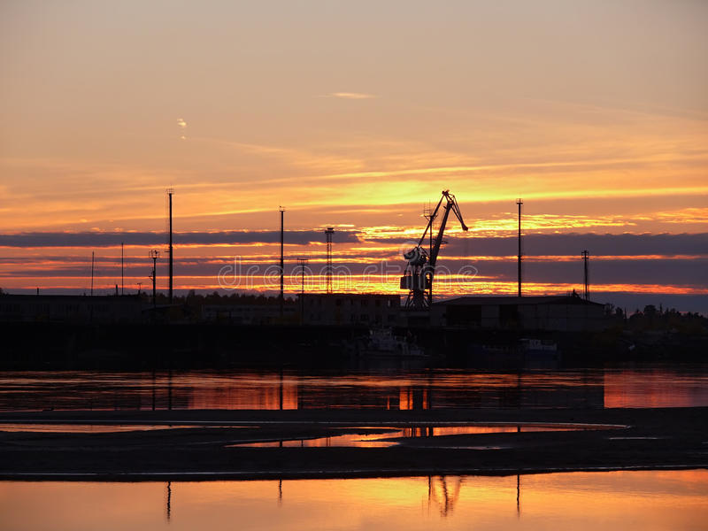 The landscape of the Northern nature. Sunset over the river Nadym. Construction on the Bank of the Nadym. stock image