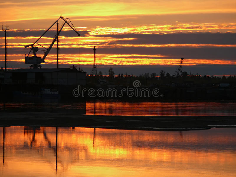 The landscape of the Northern nature. Sunset over the river Nadym. Construction on the Bank of the Nadym. stock photos