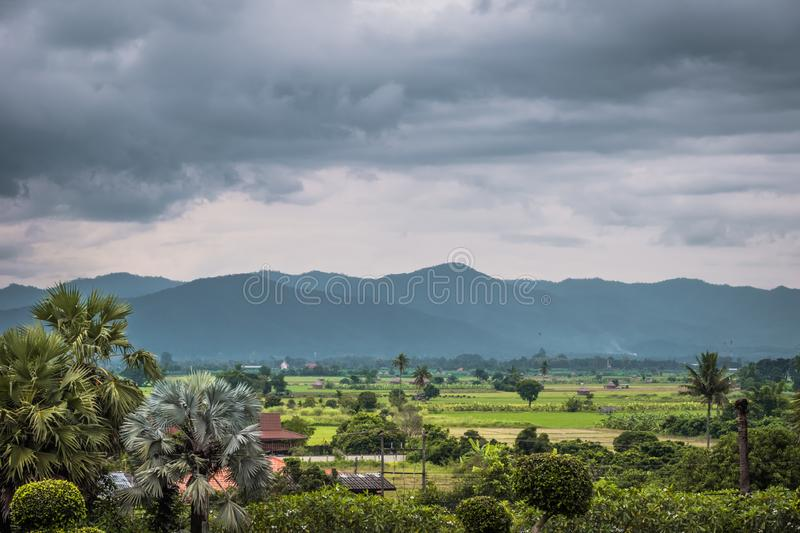 Landscape of northern of Thailand village. View of Mountain and rain cloud on background of village in Chinag Mai, Thailand royalty free stock photo