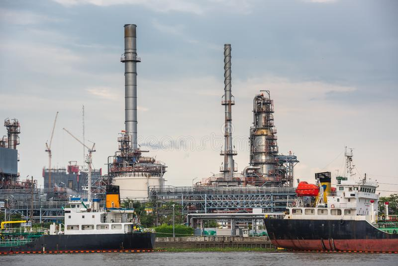 Landscape of Oil and Gas Refinery Manufacturing Plant., Shipping Dock and Chemical Distillation Process Buildings., Factory of royalty free stock images