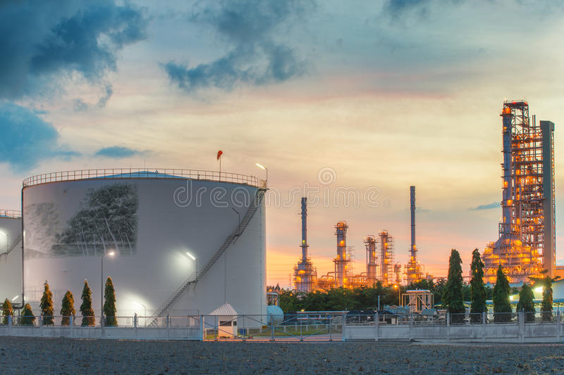 Landscape of oil refinery industry with oil storage tank.  royalty free stock image