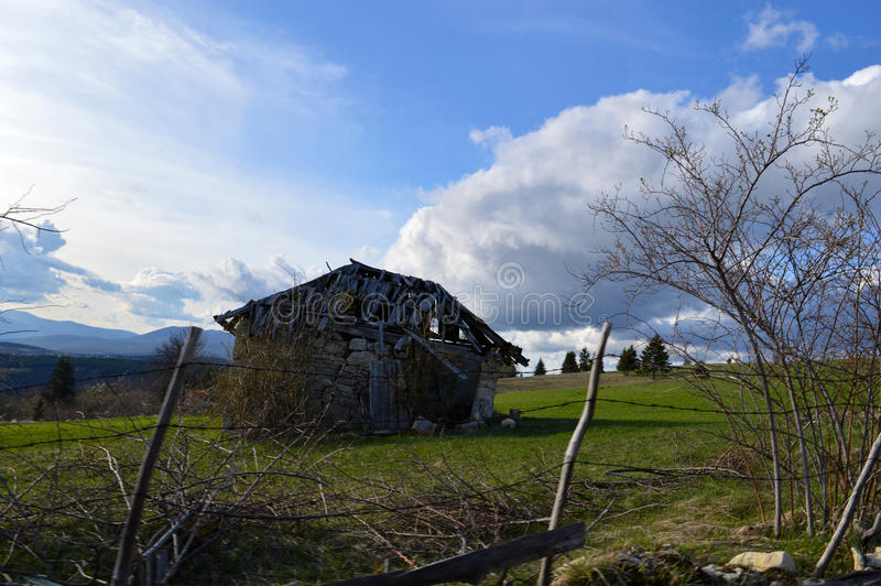 Landscape with old cabin. Nature landscape with old cabin and clouds on the sky stock photography