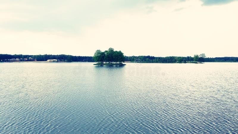 Landscape over the water. In the middle of the island sky with clouds stock photography
