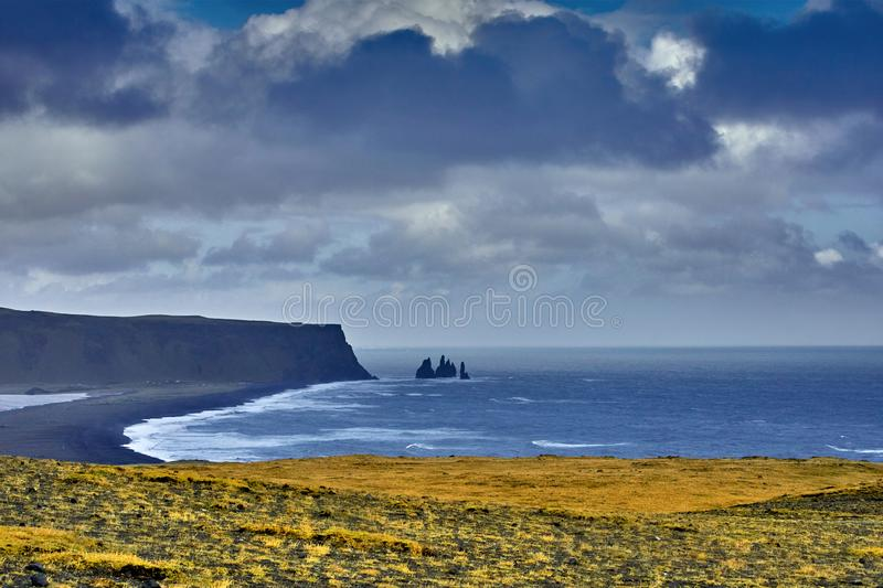Reynisdrangar, basalt rock formations, autumn 2018, Iceland. Reynisdrangar, these rocks are all that remains from what was once a cliff and if anything, they royalty free stock photography