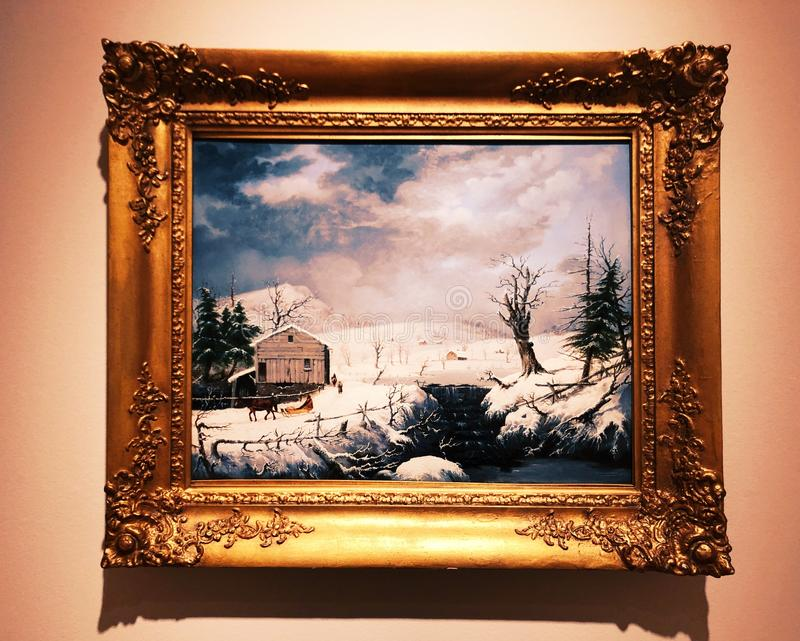 A landscape painting from New Britain Museum of American Art. A wooden cabin in the snow painting inside The New Britain Museum of American Art in New Britain royalty free stock photo