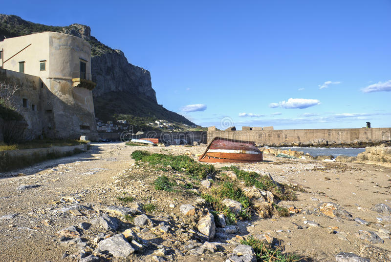 Landscape of Palermo- Arenella. Landscape of Palermo, Arenella- Sicily. old boats and fisherman in the distance stock photo