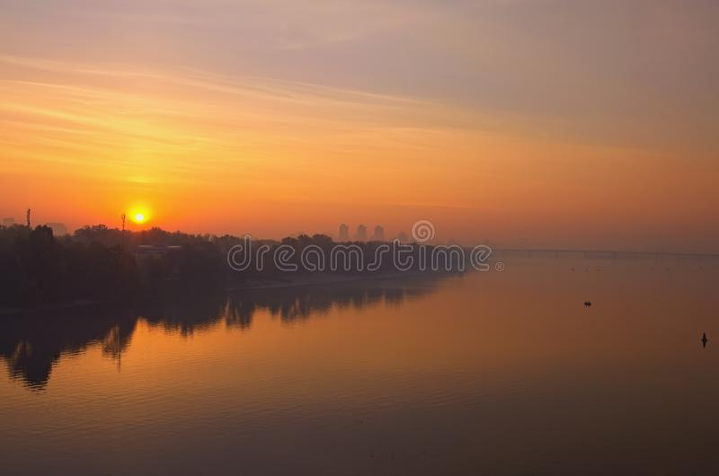 Landscape panorama of Dnipro River. Magnificent autumn sunrise in Kyiv. Foggy morning landscape. Beautiful city view with rising sun and fiery sky. Kyiv Kiev royalty free stock image