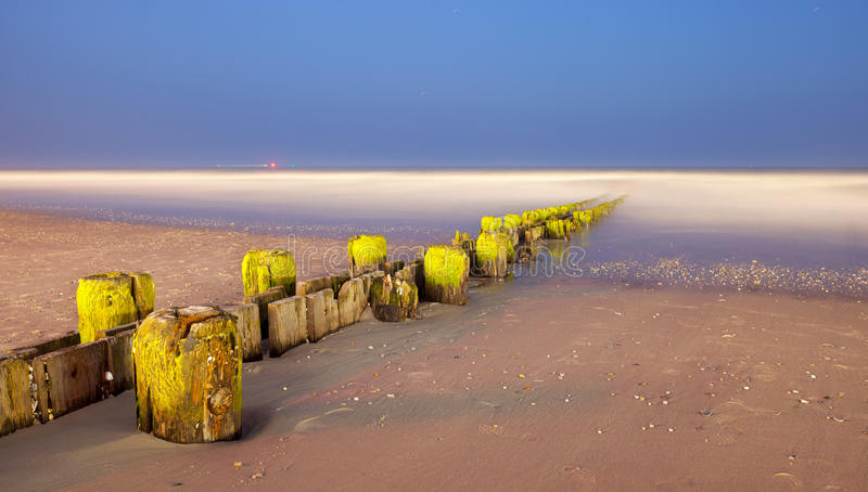 Download Landscape Panorama Of Old Pier Posts On The Beach Stock Image - Image: 31410577