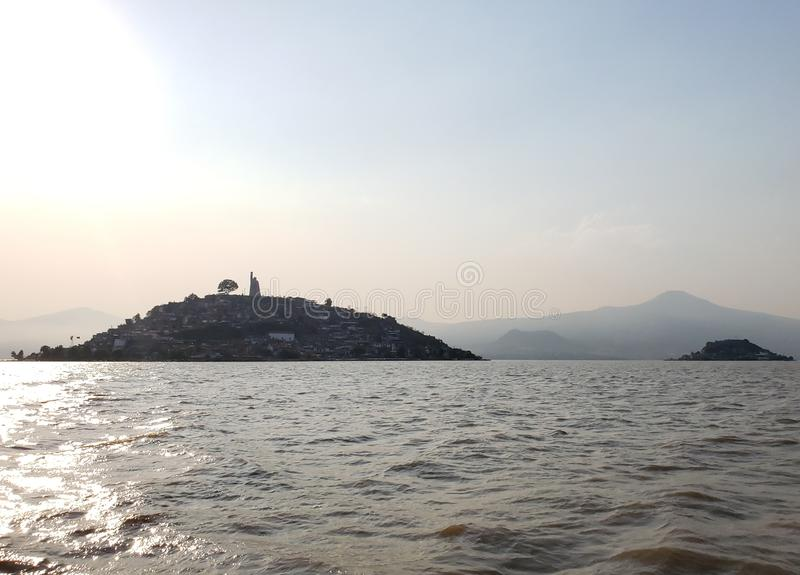 Landscape in Patzcuaro Lake, Michoacan, travel and tourism in Mexico. Landscape patzcuaro lake michoacan sunset travel tourism mexico black silhouette calm water stock image