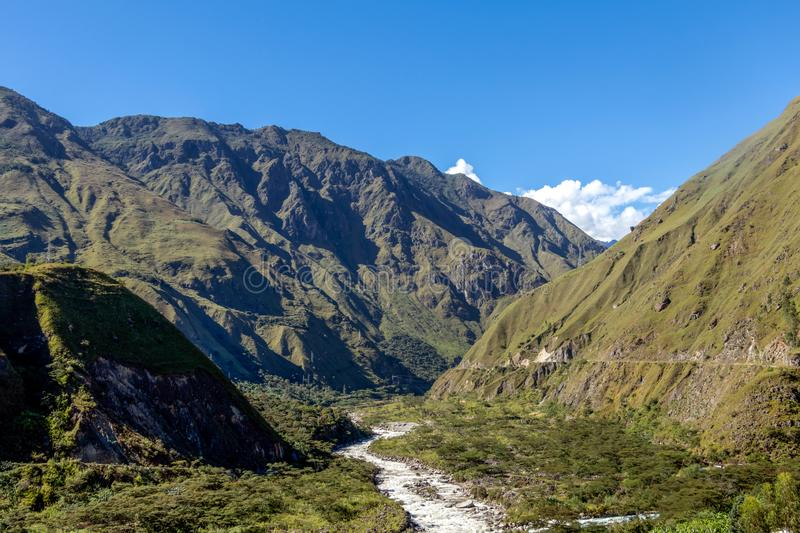 The Santa Teresa River in green lush valley. Hiking trail to Machu Picchu, Peru. Landscape of peruvian mountains with Santa Teresa River in green lush valley stock image