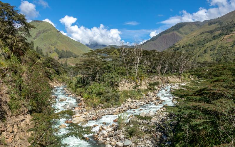 The Santa Teresa River in green lush valley. Hiking trail to Machu Picchu, Peru. Landscape of peruvian mountains with Santa Teresa River in green lush valley royalty free stock images