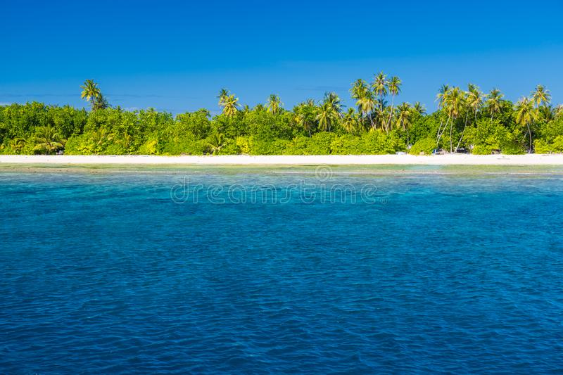 Landscape photo of beautiful paradise Maldives tropical beach on island. Summer and travel vacation concept royalty free stock photos