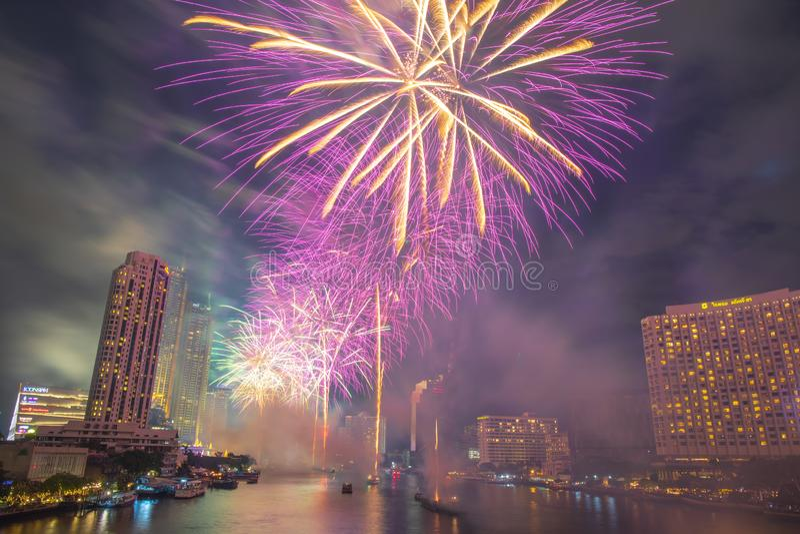 Landscape photo of firework for New Year 2020 celebration on Chao Phraya River at IconSiam or Icon Siam Department Store, Bangkok,. Bangkok, Thailand - 1 January stock photography