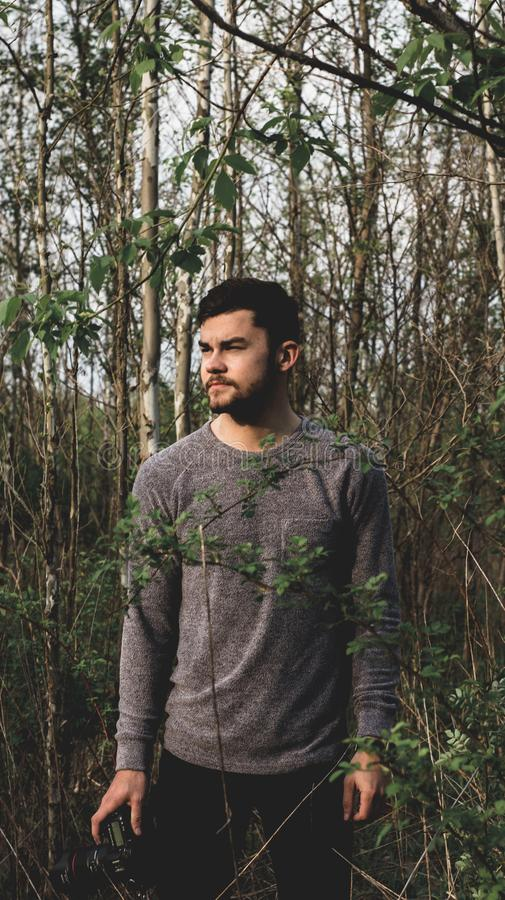 Landscape Photo of Man Standing on Forest and Wearing Crew-neck Sweatshirt royalty free stock image