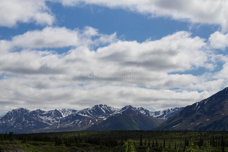 Landscape Photo of Mountain Under Blue Cloudy Sky stock images