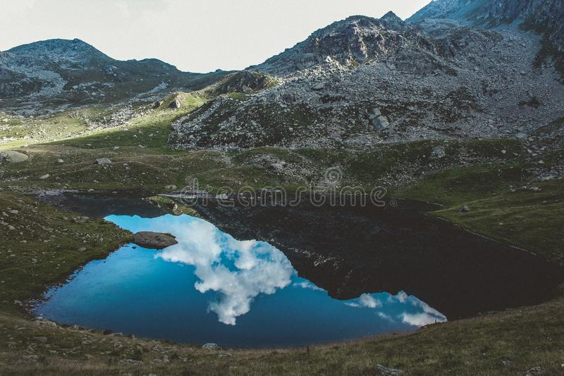 Landscape Photograph of Body of Water and Mountains royalty free stock photo