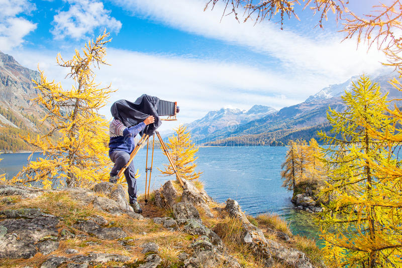 Landscape photographer with old vintage plate camera stock photography