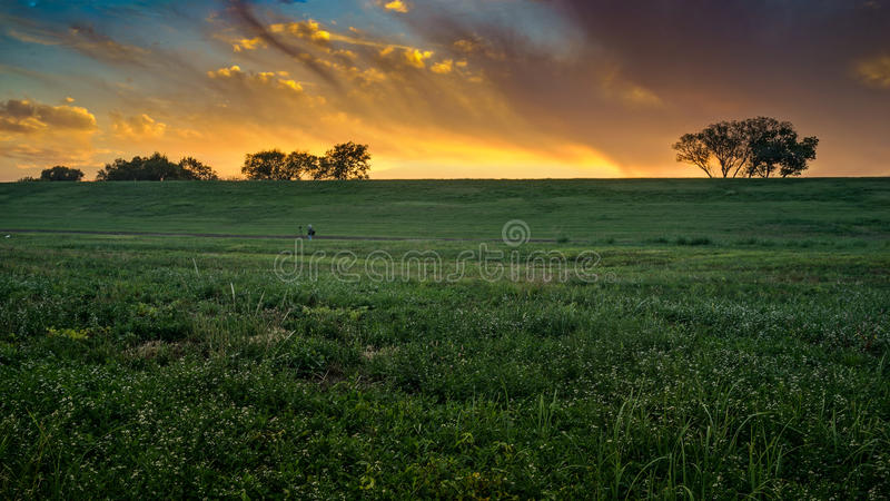 Landscape Photographer Shooting Sunset stock images