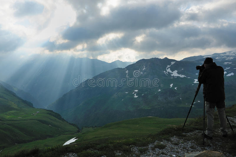 Landscape Photographer. This photographer takes a photo from the wonderful atmosphere in the alps stock image