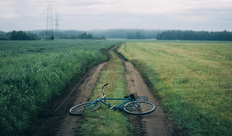 Landscape Photography of Blue Commuter Bike on Green Grass royalty free stock image