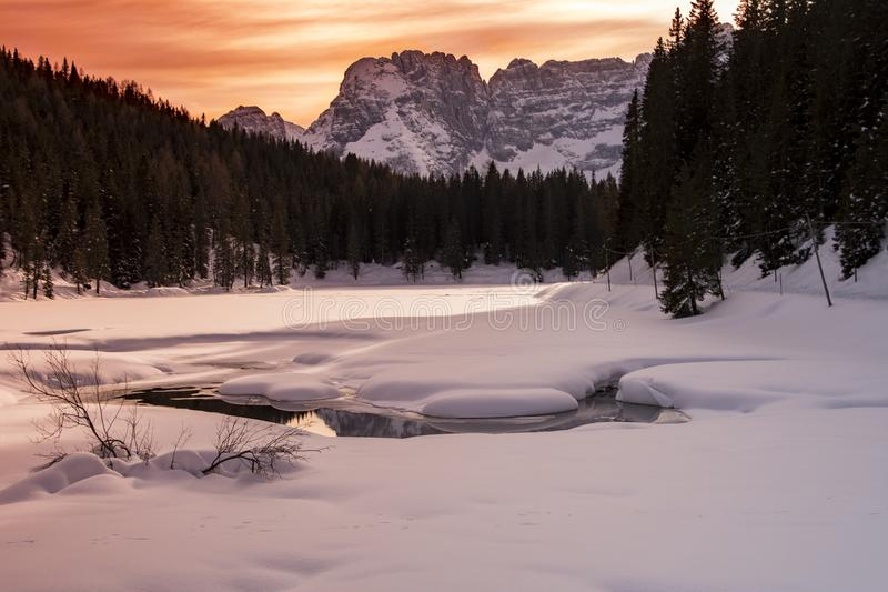 Landscape Photography Of Body Of Water Covered With Snow And Surrounded With Trees And Mountain stock photos