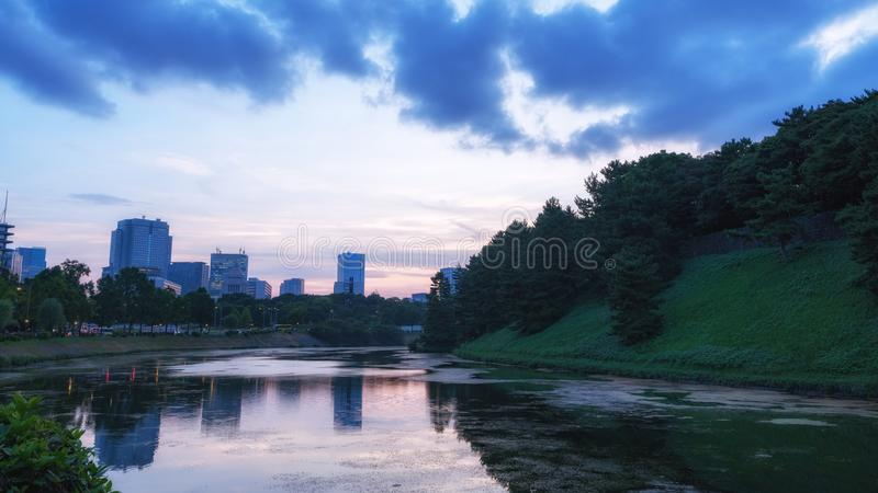 Landscape Photography of Body of Water and Green Hills royalty free stock photo