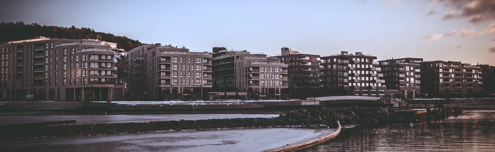 Landscape Photography of Body of Water Beside High Rise Building during Golden Hour stock images