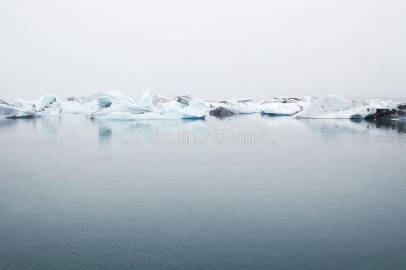 Landscape Photography of Body of Water Near Ice Berg stock photo