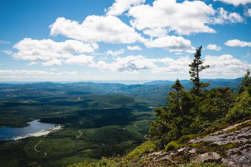 A landscape photography with mountains and clouds. A landscape photography of Charlevoix, Quebec, Canada. Grands-Jardins top view royalty free stock photography