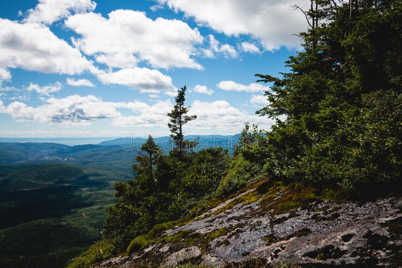 A landscape photography with mountains and clouds. A landscape photography of Charlevoix, Quebec, Canada. Grands-Jardins top view stock images