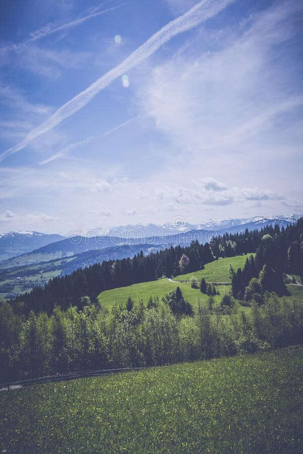 Landscape Photography of Green Grass Field Mountain royalty free stock image