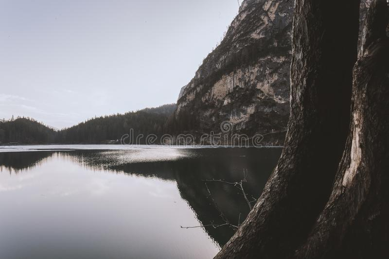 Landscape Photography of Lake Beside Cliff at Daytime stock photography