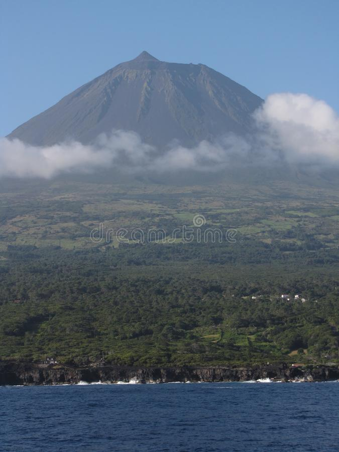 Pico. Landscape of Pico Island seen from the sea towards São Jorge stock images