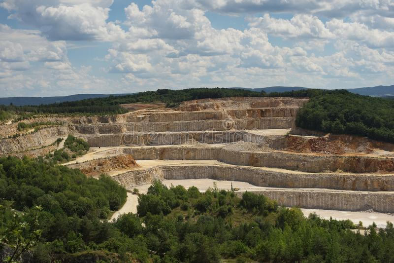 Landscape Picture on the deep opencast stone mine, quarry or surface, strip mine. stock images