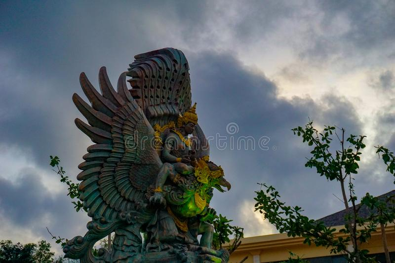 Picture of Garuda statue as Bali landmark with blue sky as a background. Balinese traditional symbol of hindu religion stock photo