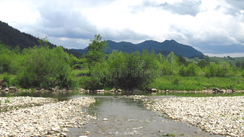 Landscape of Pieniny. Dunajec river and some trees and mountains behind it stock photos