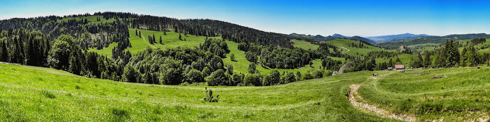 Wide panorama of Pieniny range in southern Poland. Landscape of Pieniny and Gorce mountain range in beskids in Poland. Pieniny Mountains in the south of Poland royalty free stock image