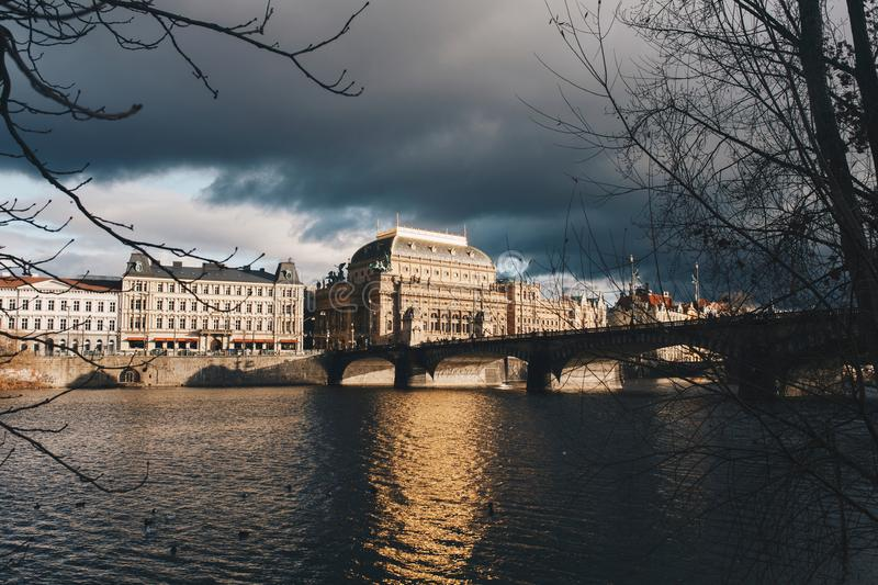 Landscape of Prague buildings near brigde and river outdoor stock images