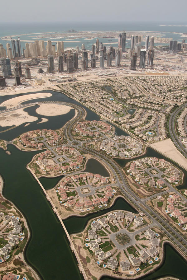 Landscape of Properties in Dubai. The Palm Island in the sea & Waterfront Properties Along Sheikh Zayed Road In Dubai royalty free stock photos