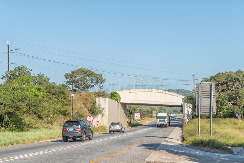 Landscape with railroad bridge on N4 between Nelspruit and Malalane. NELSPRUIT, SOUTH AFRICA - MAY 3, 2019: A landscape on road N4 between Nelspruit and Malalane stock photography