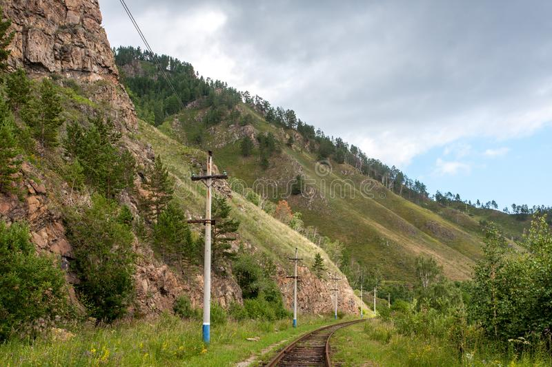 Landscape with railway tracks in the mountains stock photo