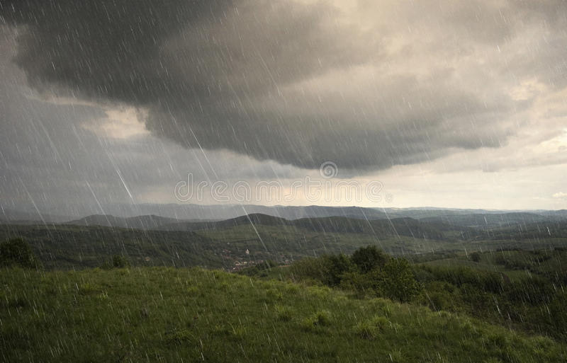 Landscape with rain and dramatic clouds over hills royalty free stock images